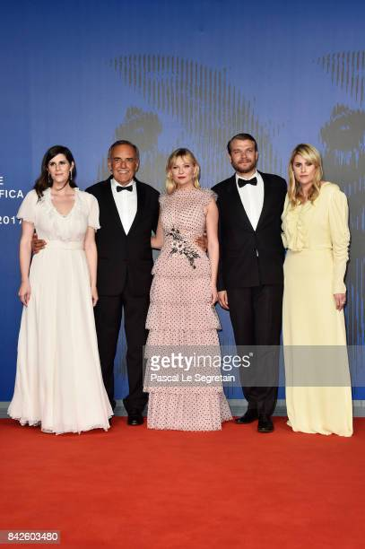 Laura Mulleavy festival director Alberto Barbera Kirsten Dunst Pilou Asbaek and Kate Mulleavy walk the red carpet ahead of the 'Woodshock' screening...