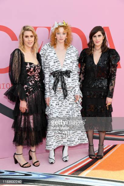 Laura Mulleavy, Lily Nova and Kate Mulleavy attend the CFDA Fashion Awards at the Brooklyn Museum of Art on June 03, 2019 in New York City.