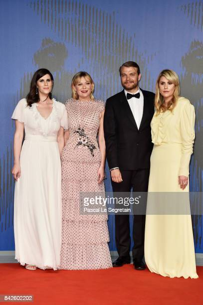 Laura Mulleavy Pilou Asbaek Kirsten Dunst and Kate Mulleavy walk the red carpet ahead of the 'Woodshock' screening during the 74th Venice Film...