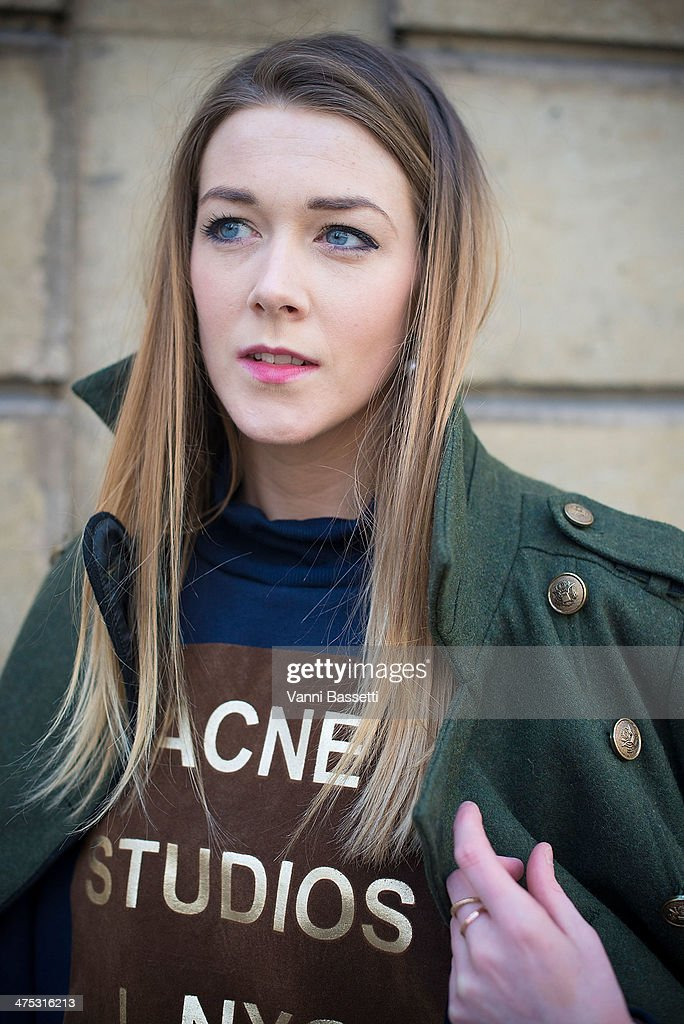 Laura Murphy wears Urban Outfitters coat and ACNE Studios sweater before Alexis Mabille show on February 26, 2014 in Paris, France.