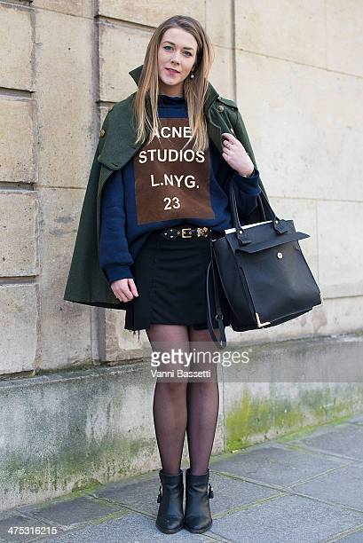 Laura Murphy wears Urban Outfitters shoes and coat Zara skirt and bag and ACNE Studios sweater before Alexis Mabille show on February 26 2014 in...