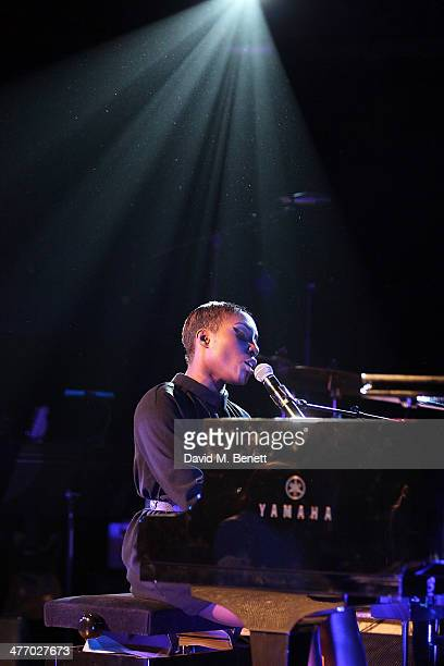 Laura Mvula performs at the 'Kids Company Heart Of Gold' fundraising dinner at the Porchester Hall on March 6 2014 in London England