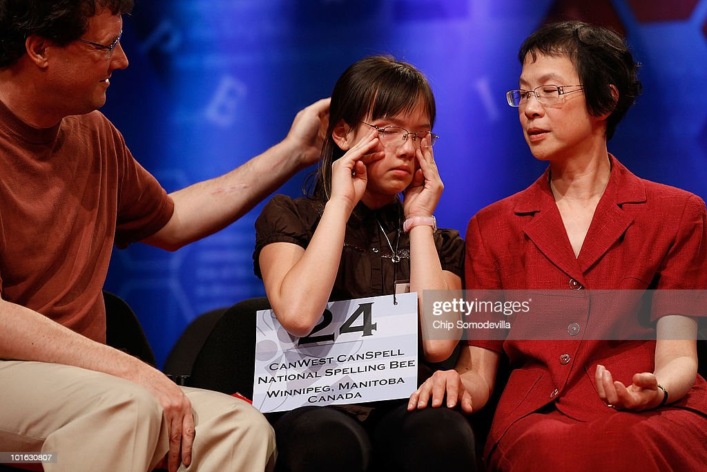 Laura Newcombe of Toronto, Canada, is comforted by her parents after misspelling 'confiserie' during the final rounds of the Scripps National Spelling Bee June 4, 2010 in Washington, DC. 273 spellers from across the country competed to win the national titile.