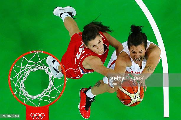 Laura Nicholls of Spain drives to the basket against Dragana Stankovic of Serbia during the first half of the Women's Semifinal game on Day 13 of the...