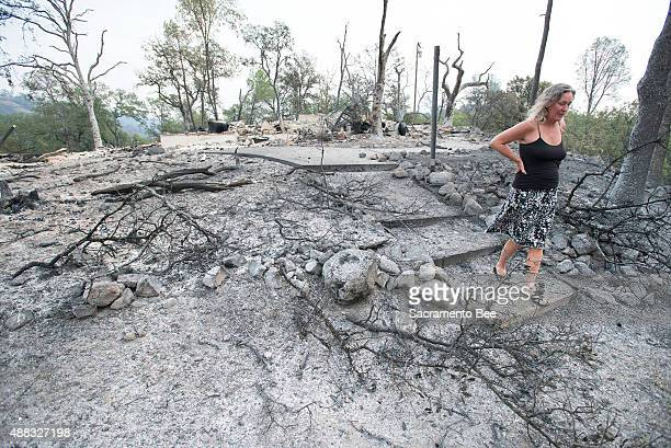 Laura Nichols walks through the burnedout property of her best friend in Middletown on Sunday Sept 13 in Lake County Calif Her friend Lisa Kaplan a...