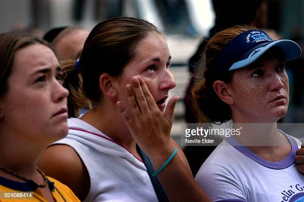 Laura Nicol from Aberdeen, Scotland; Suzanne Letham from Borders, Scotland and Sinead Doherty, 20 from Glasgow, Scotland, share an emotional moment...