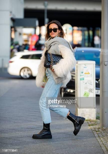 Laura Noltemeyer is seen wearing grey scarf, black Chanel bag, white fake fur jacket, denim jeans, black ankle boots, sunglasses on November 14, 2019...