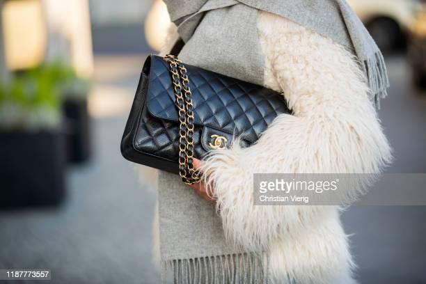 Laura Noltemeyer is seen wearing grey scarf, black Chanel bag, white fake fur jacket on November 14, 2019 in Berlin, Germany.