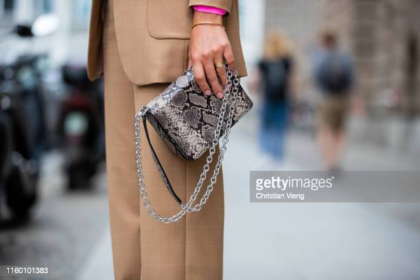 Laura Noltemeyer is seen wearing total look Marc Cain brown suit, bag with snake print during Berlin Fashion Week on July 02, 2019 in Berlin, Germany.