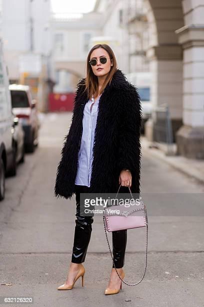 Laura Noltemeyer wearing a black fur jacket Valentino bag pvc pants during the MercedesBenz Fashion Week Berlin A/W 2017 at Kaufhaus Jandorf on...