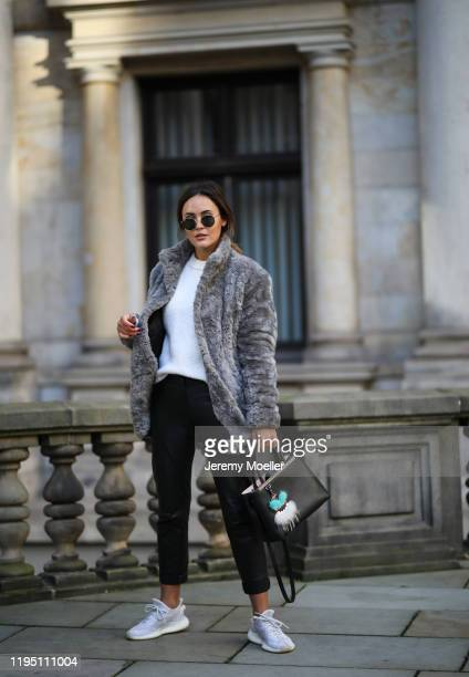 Laura Noltemeyer wearing Adidas sneaker Fendi bag Marco Polo sweater Tiger of Sweden jacket and leather pants on December 19 2019 in Hamburg Germany