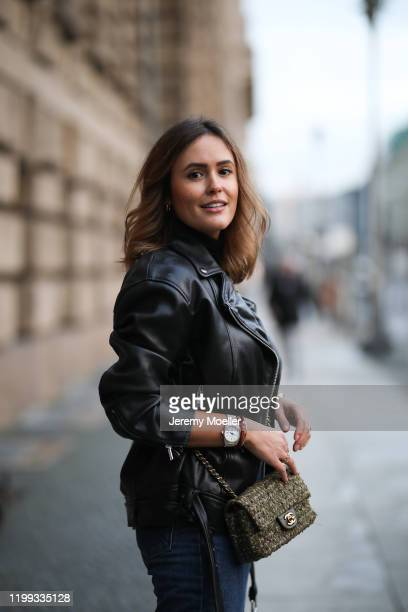 Laura Noltemeyer wearing Chanel bag, Zara jacket and boots, Topshop Jeans, Vintage belt and Riani turtleneck during the Berlin Fashion Week...