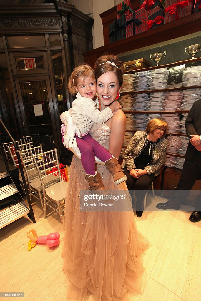 Laura Osnes, Cinderella from Rodgers and Hammerstein's Cinderella, poses with a guest during The Brooks Brothers Hosts Seventh Annual Holiday Celebration To Benefit St Jude Children's Research Hospital on December 12, 2012 in New York City.