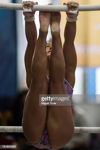 Laura Pardo of Colombia competes in uneven bars as part of the I ODESUR South American Youth Games at Coliseo Miguel Grau on September 25 2013 in...