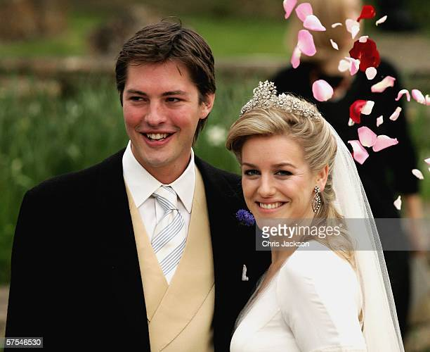 Laura Parker Bowles and Harry Lopes pose as they leave St Cyriac's Church Lacock having married on May 6 2006 in Wiltshire England 26year old Laura...