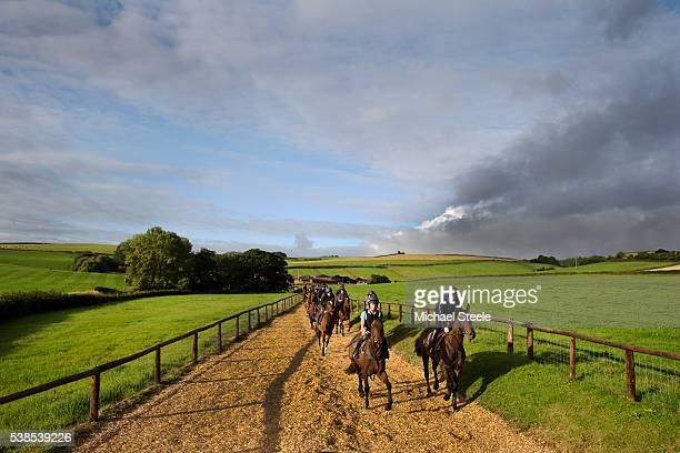 Laura Parker riding Walter White head towards the woodchip start alongside Tom O'Brien riding Ten Sixty at Sandhill Racing Stables on September 4...