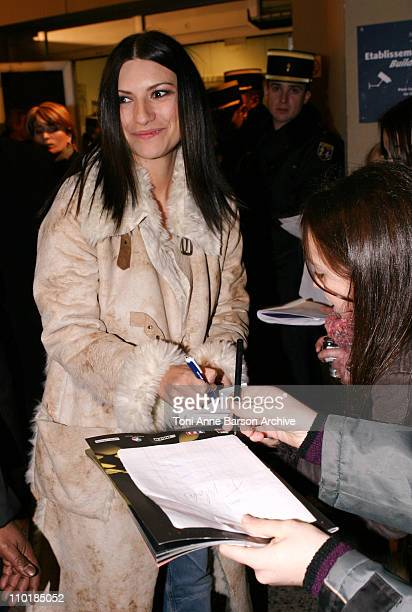 Laura Pausini signing autographs during 2004 NRJ Music Awards Back Exit / After Show Departure at Palais des Festivals in Cannes France