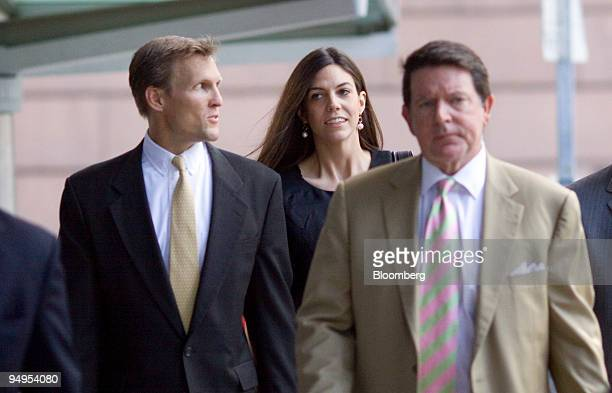Laura PendergestHolt chief investment officer of Stanford Financial Group Co center walks to the federal courthouse with her attorney Dan Cogdell...