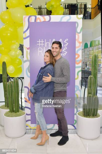 Laura Perlongo and Nev Schulman attend Barneys New York Celebrates Haas for the Holidays Hosted by Matthew Mazzucca Nikolai Haas and Simon Haas at...