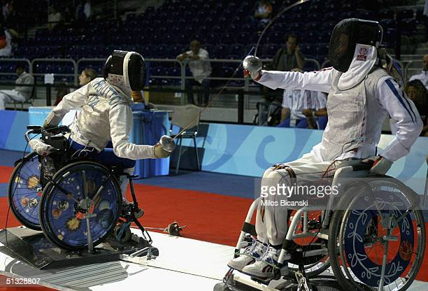 Laura Persutto of Italy and Loredana Trigila of France duel during their Women's Individual Foil Wheelchair Fencing contest at the Athens 2004...
