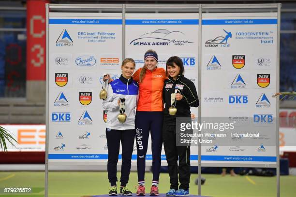 Laura Peveri of Italy Elisa Dul of Netherlands and Lemi Williamson of Japan pose during the medal ceremony of the Ladies mass start the ISU Junior...