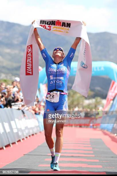 Laura Philipp of Germany crosses the line to win the Women's IRONMAN 703 Marbella on April 29 2018 in Marbella Spain