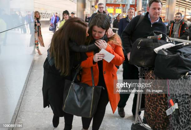 Laura Plummer is embraced by her sister Rachel at Heathrow Airport following her return to the UK after being released from a prison sentence in Egypt