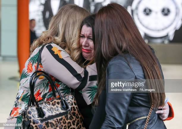 Laura Plummer is embraced by her sisters Jayne and Rachel at Heathrow airport following her return to the UK after being released from a prison...
