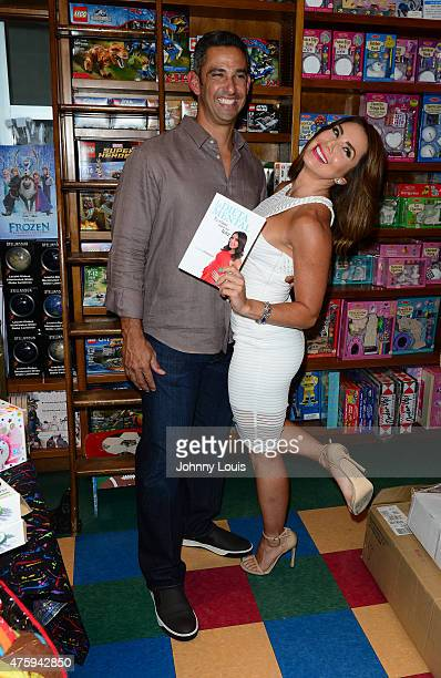 Laura Posada and husband Jorge Posada pose after greeting fans and signs copies of her book 'La dieta mental' at Books and BooksGables on June 4 2015...