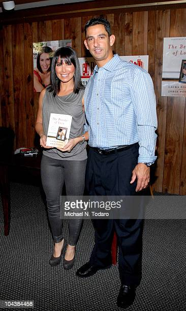 """Laura Posada and Jorge Posada promote """"The Beauty of Love"""" at Bookends Bookstore on September 23, 2010 in Ridgewood, New Jersey."""