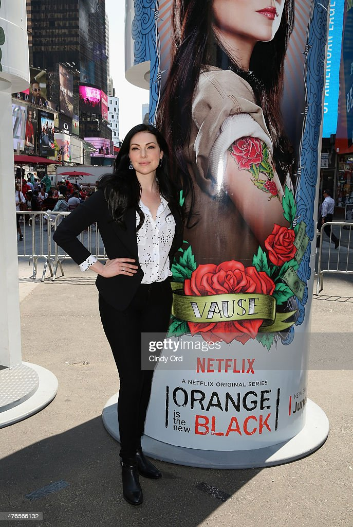 Laura Prepon from the cast of the hit Netflix original series 'ORANGE IS THE NEW BLACK' keeps the faith at a giant 14 foot tall candle-shaped photo booth in New York's Times Square on June 10, 2015 in New York City. The interactive photo booths project users' photos on to enormous displays in Times Square. 'ORANGE IS THE NEW BLACK' Season 3 premieres on Friday, June 12.