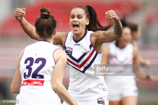 Laura Pugh of the Dockers celebrates with Gemma Houghton of the Dockers after kicking a goal during the round six AFLW match between the Western...