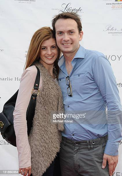 Laura Putnam and Michael Dean Shelton attend the 2010 Beverly Hills Fashion Fair Arrivals on November 6 2010 in Los Angeles California