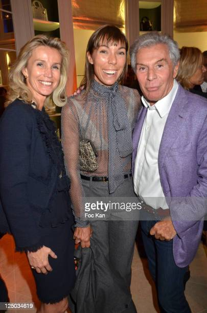 Laura Restelli Brizard, Mathilde Favier and Jean Daniel Lorieux attend the Vogue Fashion Celebration Night 2011 at Dior Boutique in Paris on...