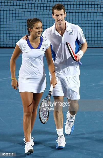 Laura Robson and Andy Murray of Great Britain celebrate winning a tie break point in their mixed doubles game against Yaroslava Shvedova and Andrey...