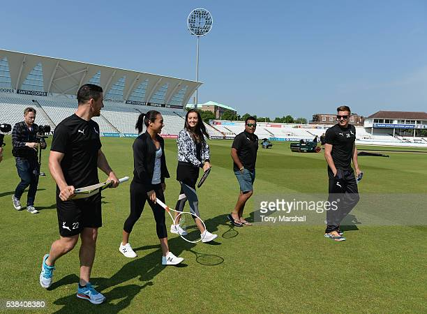 Laura Robson and Heather Watson of Great Britain take to the field at Trent Bridge with Samit Patel Jake Ball and Greg Smith of Nottinghamshire CCC...