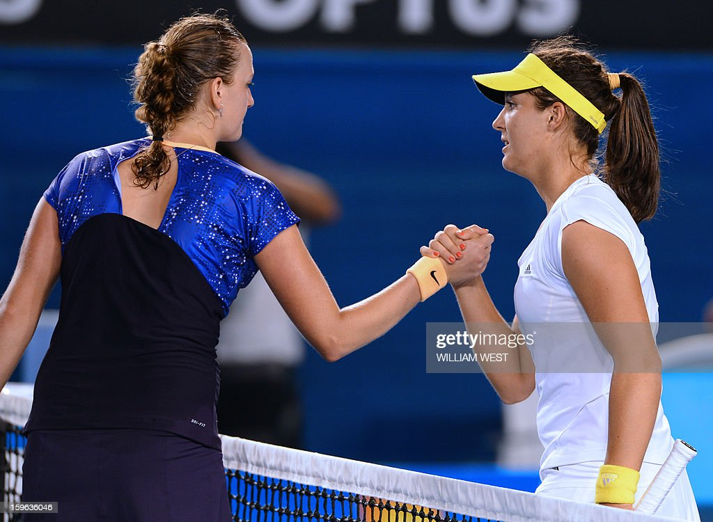 Laura Robson of Britain shakes hands after victory in her women's singles match against Czech Republic's Petra Kvitova on the fourth day of the Australian Open tennis tournament in Melbourne on January 17, 2013.