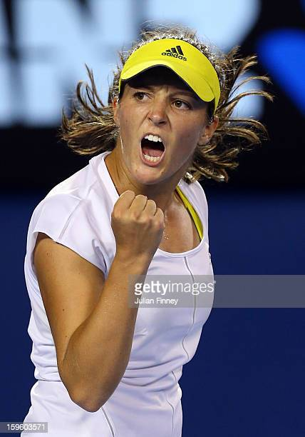 Laura Robson of Great Britain celebrates in her second round match against Petra Kvitova of Czech Republic during day four of the 2013 Australian...