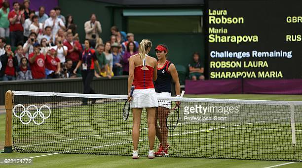 Laura Robson of Great Britain congratulates the victorious Maria Sharapova of Russia at the conclusion of their Women's Singles Tennis match on Day 4...