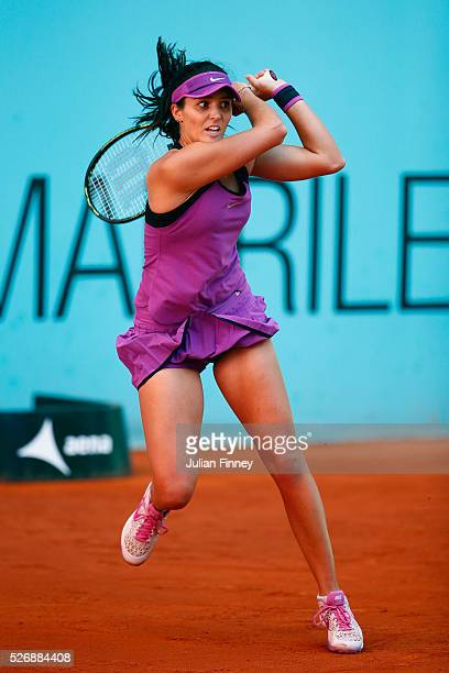 Laura Robson of Great Britain in action against Victoria Azarenka of Belarus during day two of the Mutua Madrid Open tennis tournament at the Caja...