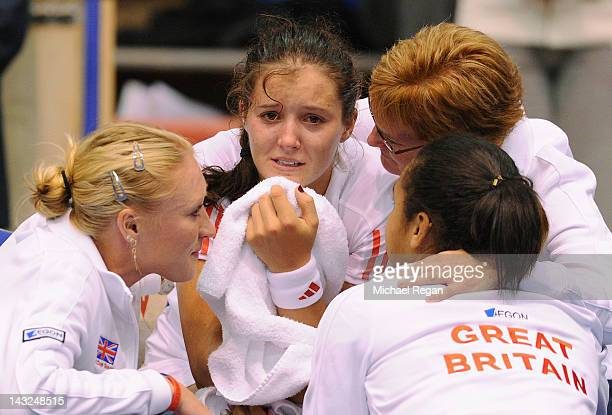 Laura Robson of Great Britain is consoled by team mates Elena Baltacha, Heather Watson and captain Judy Murray after losing her match against Sofia...