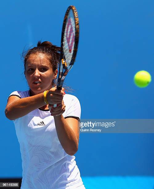 Laura Robson of Great Britain plays a backhand in her first round juniors match against Belinda Woolcock of Australia during day eight of the 2010...