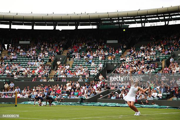 Laura Robson of Great Britain serves during the Ladies Singles first round match against Angelique Kerber of Germany on day one of the Wimbledon Lawn...