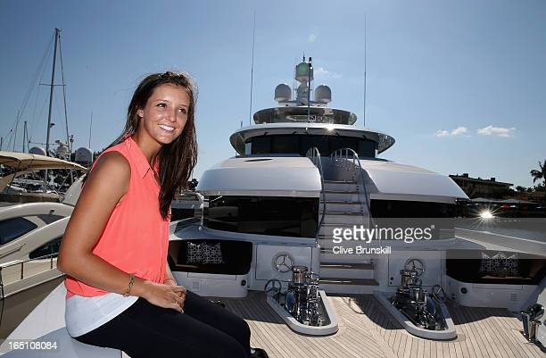 Laura Robson of Great Britain takes some time out in Miami prior to her doubles final tomorrow against Nadia Petrova of Russia and Katarina...