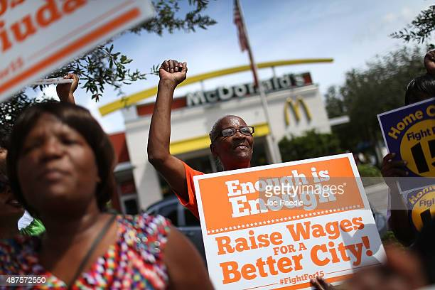 Laura Rollins joins with others to protest in front of a McDonald's restaurant in support of a $15 an hour minimum wage on September 10 2015 in Fort...