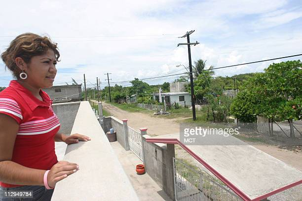 Laura Ruiz now 17 looks out from the balcony of her family home near Tampico Mexico She was 8 years old when her father Francisco left for the United...