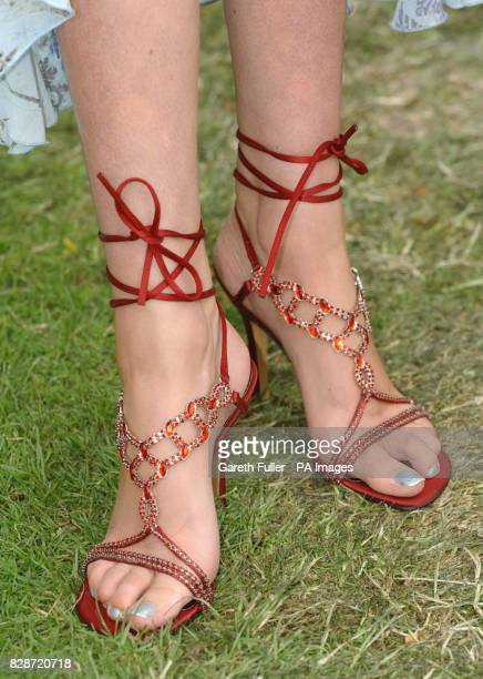 Laura Rumble models shoes worth 1 million, made with 800 rubies,for the ladies day meeting at Royal Ascot.