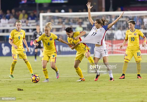 Laura Rus Ioana Bortan Andreea Corduneanu and Andreea Voicu of Romaina and Tobin Heath of the USA play in a soccer game against Romania on November...