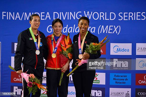 Laura Sanchez form Mexico silver medal Zi He from China gold medal and Jennifer Abel from Canada bronze medal during the Women's 3 meters Springboard...