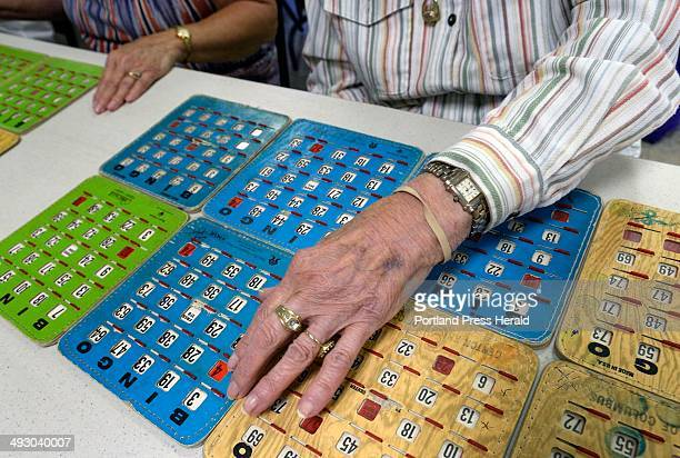 Laura Saucier 91 looks over her cards during a game of Bingo at the Eagle Lake Senior Center Aug 26 2013 é·The first winner always gets the best...